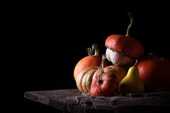 Pumpkins on wooden table in dark background. Selective focus Royalty Free Stock Photography