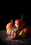 Pumpkins on wooden table in dark background. Selective focus Stock Images