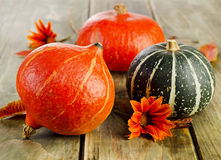 Pumpkins on wooden table Stock Photography
