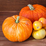 Pumpkins on a wooden table Stock Photo