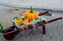 Pumpkins  on a wooden wheelbarrow Royalty Free Stock Photo