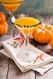 Pumpkintini pumpkin martini coctail. With black salt rim for fall and halloween parties Stock Photo
