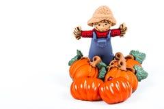 Pumpor och scarecrow royaltyfri illustrationer