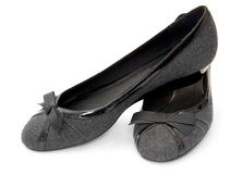 Pumps. Grey pumps with a bow Stock Images