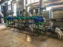 Pumps, valves and piping hot and cold water Stock Images