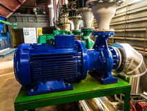 Pumps, valves and piping hot and cold water Stock Photos