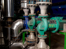 Pumps, valves and piping hot and cold water Stock Photography