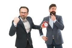 Puna para não a pontualidade Executivos da roupa formal que tem a opinião diferente sobre o tempo Gestão de tempo fotos de stock royalty free