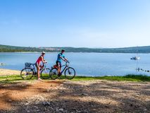 Free Punat - Couple On The Bikes In Front Of A Seashore Royalty Free Stock Photo - 158584185