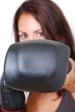 Punch. Girl with boxing gloves throwing a punch Stock Photography