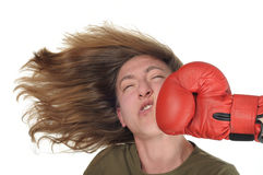Punch. Woman getting a hard punch in her face stock photos