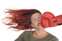 Punch. Woman getting a hard boxing punch royalty free stock photos