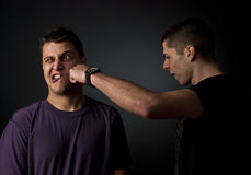 Punch. Fist in the face - knockout Royalty Free Stock Photography