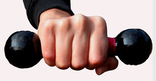 Punch. A hand keeping with force a barbells-isolation Royalty Free Stock Photos