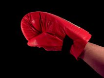Punch. Man with a boxing glove on royalty free stock photo