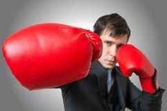 Punch of boxing businessman in suit. Fighting concept Stock Images