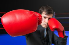 Punch of boxing businessman in suit. Fighting concept Royalty Free Stock Photography