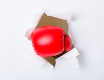 Punch break through paper wall Royalty Free Stock Photo