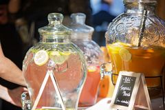 Punch And Chilled Water For Refreshments. Large jars filled with water, fruit punch and lemon slices to serve as refreshments to wedding and party guests royalty free stock photography