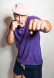Punch with clenched fist of a handsome young man Royalty Free Stock Image