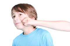 Punch in the face. Punch in the child face  on white background Royalty Free Stock Photo