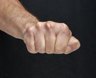 Punch fist on a Black background Stock Photos