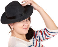 punch girl in hat discontentedly wrinkles a nose Stock Photos