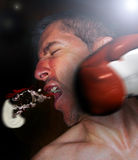 Punch impact. A man receiving a punch impact and losing his tooth protector royalty free stock image