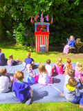 Puppet show on grass lawn Stock Photography