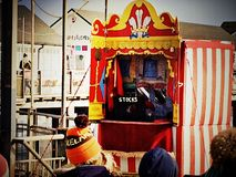 Punch and Judy show along the seafront in Southwold, Norfolk. Children& x27;s entertainment at the seaside Stock Photography