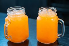 Punch juice in the glass on the table. stock image
