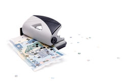Punch and leaky banknote Royalty Free Stock Image