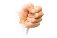 Punch out. Fist broken paper. Royalty Free Stock Image