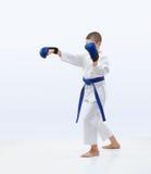 Punch in perfoming karateka in karategi. Punch arm in perfoming karateka in karategi Stock Photography