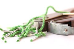 Punch and string. A hole punch sits with some string document ties Stock Images
