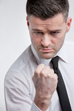 Punch threat by angry dangerous man stock photography