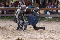 Punched. A Knight gets punched in the head at the Sherwood Forest Faire in McDade, Texas Stock Photos