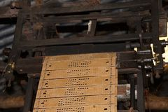 Punched card driven weaving machine Stock Images