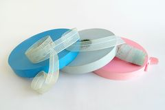 Punched tapes. Colorful punched tapes on a white background Stock Photos