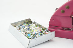 Puncher and confetti. Stapler can create a lots of circle waste paper for art Royalty Free Stock Photo