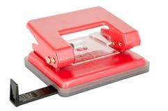 Puncher de agujero de papel de la oficina en el fondo blanco Fotos de archivo