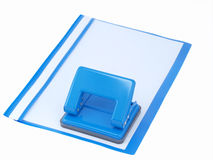 Puncher and folder with papers. Blue puncher and blue folder with papers on white royalty free stock photo