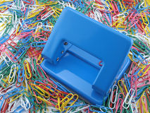 Puncher and paper clips Stock Photography