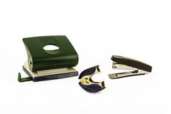 Puncher, stapler and anti-stapler on a light background Stock Photo