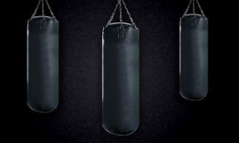 Punching bag. Black Punching bag for boxing or kick boxing sport Royalty Free Stock Photography