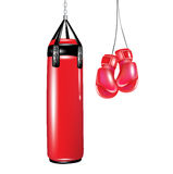 Punching bag and boxing gloves Royalty Free Stock Photos