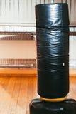 Punching bag for boxing at gym interior Stock Photos