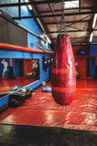 Punching bag hanging from ceiling Stock Photo