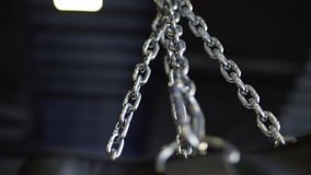 Punching bag hanging in the gym on the chains. Punching bag chain Royalty Free Stock Photography