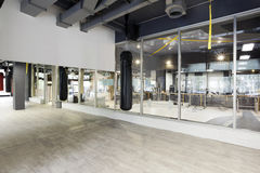 Punching bag in modern gym Stock Photos